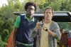 "BEN AND KATE: Ben (Nat Faxon, R) and Tommy (Echo Kellum, L) watch as Kate approaches with all of her findings from the scavenger hunt in ""The Fox Hunt"" episode of BEN AND KATE airing Tuesday, Oct. 9 (8:30-9:00 PM ET/PT) on FOX. ©2012 Fox Broadcasting Co. Cr: Jennifer Clasen/FOX"