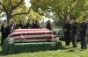 "BONES:   Brennan (Emily Deschanel, fifth from R), Booth (David Boreanaz, second from R), the Jeffersonian team and interns attend the funeral of a man who died as a result of the 9/11 terrorist attacks in the ""The Patriot in Purgatory"" episode of BONES airing Monday, Nov. 12 (8:00-9:00 PM ET/PT) on FOX.  Also pictured L-R:  Eugene Byrd, Luke Kleintank, TJ Thyne, Joel David Moore, Michaela Conlin, Michael Grant Terry, John Francis Dayley, Pej Vahdat and Tamara Taylor.  ©2012 Fox Broadcasting Co.  Cr:  Patrick McElhenney/FOX"