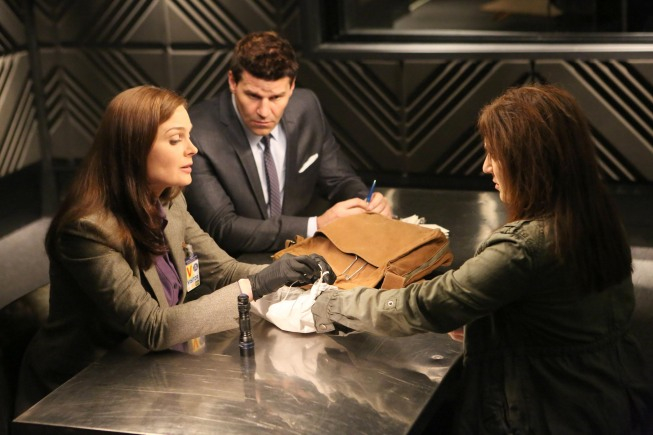 """BONES:  Brennan (Emily Deschanel, L) and Booth (David Boreanaz, C) interview a woman (guest star Rona Benson, R) whom they suspect may be involved in the death of an ex-military officer in the """"The Doom in the Gloom"""" episode of BONES airing Monday, March 18 (8:00-9:00 PM ET/PT) on FOX.  ©2013 Fox Broadcasting Co.  Cr:  Adam Taylor/FOX"""