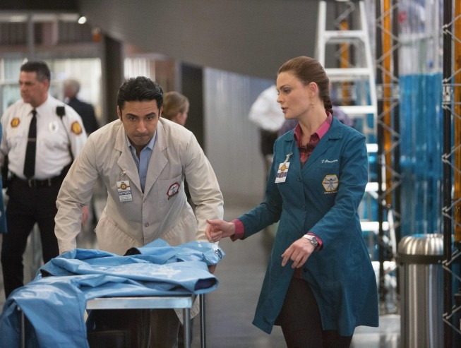 "BONES:  Brennan (Emily Deschanel, R) and Jeffersonian intern Arastoo Vaziri (guest star Pej Vahdat, L) rush to prevent a viral outbreak linked to their murder investigation in the ""The Pathos in the Pathogens"" episode of BONES airing Monday, April 22 (8:00-9:00 PM ET/PT) on FOX. ©2013 Fox Broadcasting Co.  Cr:  Michael Desmond/FOX"