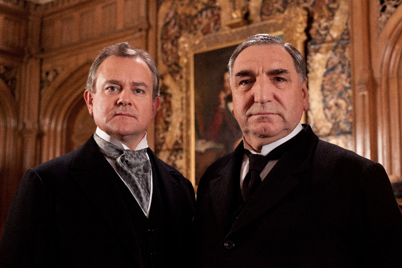 Downton Abbey Season 3 Sundays, January 6 - February 17, 2013 on MASTERPIECE on PBSFrom left to right: Hugh Bonneville as Lord Grantham and Jim Carter as Mr. Carson© Carnival Film & Television Limited 2012 for MASTERPIECEThis image may be used only in the direct promotion of MASTERPIECE CLASSIC. No other rights are granted. All rights are reserved. Editorial use only. USE ON THIRD PARTY SITES SUCH AS FACEBOOK AND TWITTER IS NOT ALLOWED.