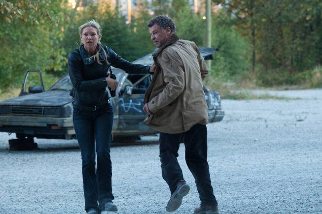 "FRINGE: Olivia (Anna Torv, L) and Walter (John Noble, R) run for safety in the ""The Bullet That Saved the World"" episode of FRINGE airing Friday, Oct. 26  (9:00-10:00 PM ET/PT) on FOX. ©2012 Fox Broadcasting Co. CR: Liane Hentscher/FOX"