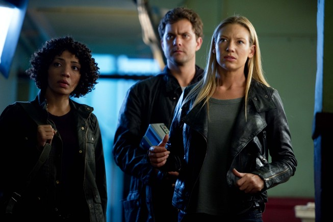 "FRINGE: Astrid (Jasika Nicole, L), Peter (Josh Jackson, C) and Olivia (Anna Torv, R) discover clues in an abandoned apartment building in the ""Through the Looking Glass (And What Walter Found There)"" episode of FRINGE airing Friday, Nov. 9 (9:00-10:00 PM ET/PT) on FOX. ©2012 Fox Broadcasting Co. CR:Diyah Pera/FOX"