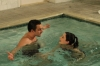 "NEW GIRL:  Nick (Jake Johnson, L) shows Jess (Zooey Deschanel, R) the benefits of water therapy in the ""Menzies"" episode of NEW GIRL airing Tuesday, Nov. 13 (9:00-9:30 PM ET/PT) on FOX.  ©2012 Fox Broadcasting Co.  Cr:  Patrick McElhenney/FOX"