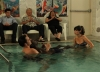 "NEW GIRL:  Nick (Jake Johnson, second from L) shows Winston (Lamorne Morris, third from R) and Jess (Zooey Deschanel, R) the benefits of water therapy while Schmidt (Max Greenfield, L) looks on in the ""Menzies"" episode of NEW GIRL airing Tuesday, Nov. 13 (9:00-9:30 PM ET/PT) on FOX.  Also pictured: Ralph Ahn (third from L).  ©2012 Fox Broadcasting Co.  Cr:  Patrick McElhenney/FOX"