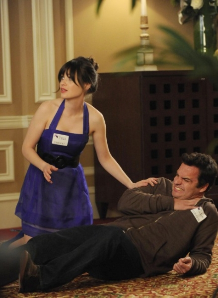 "NEW GIRL:  Jess (Zooey Deschanel, L) helps Nick (Jake Johnson, R) after Sam punches him in the ""Marriage"" episode of NEW GIRL airing Tuesday, Feb. 5 (9:00-9:30 PM ET/PT) on FOX.  ©2013 Fox Broadcasting Co.  Cr: Ray Mickshaw/FOX"
