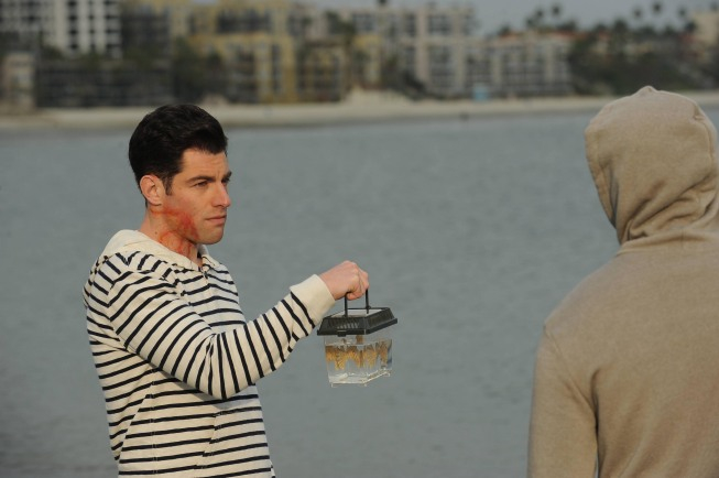 "NEW GIRL:  Schmidt (Max Greenfield, L) and Winston (Lamorne Morris, R) head to the beach to put a rare fish back in the ocean in the ""Guys Night"" episode of NEW GIRL airing Tuesday, March 19 (9:00-9:30 PM ET/PT) on FOX.  ©2013 Fox Broadcasting Co.  Cr:  Ray Mickshaw/FOX"