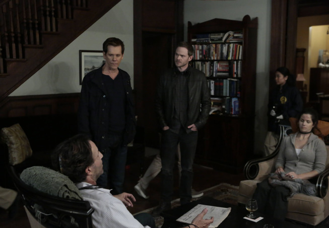 """THE FOLLOWING: Ryan Hardy (Kevin Bacon, L) and Mike Weston (Shawn Ashmore, R) visit a crime scene in the """"For Joe"""" Season Premiere episode of THE FOLLOWING airing Monday, Jan. 27 (9:00-10:00 PM ET/PT) on FOX. ©2014 Fox Broadcasting Co. CR: Giovanni Rufino/FOX"""